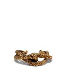 Twisted interlocking cuff