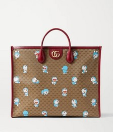 Doraemon textured leather-trimmed printed coated-canvas tote
