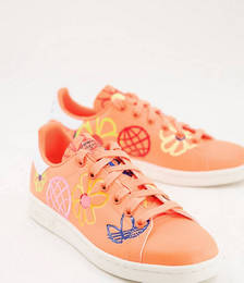 Sustainable Stan Smiths in Orange with All-over Graphic Print